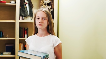 Teen girl with books