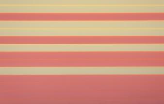 Texture de fond en bois rayé horizontal rose et jaune