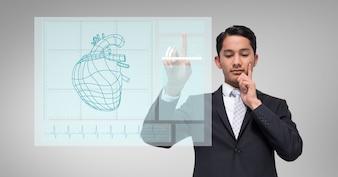 Travailleur cardiaque tenant le doigt de l'écran
