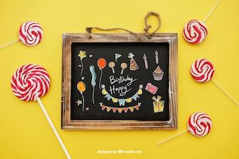 Concepto de cumpleaños con lollipop y pizarra