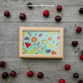 Concepto de verano con marco y cerezas
