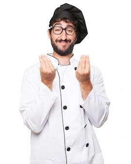 Cozinheiro chefe orgulhoso gesticulando com as mãos