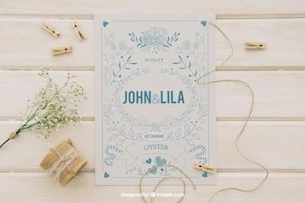 Diseño de mock up con invitación de boda y adornos