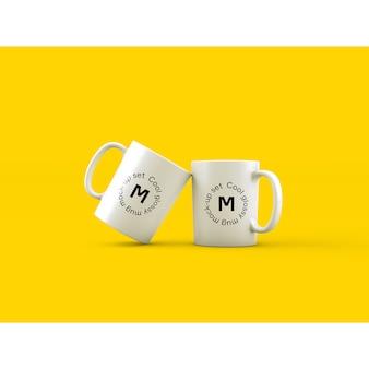 Mock up de dos tazas sobre fondo amarillo