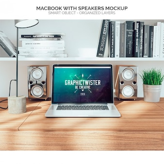 Mock up de macbook con altavoces