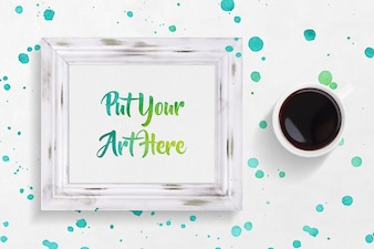 Mock up de marco con pintura y café