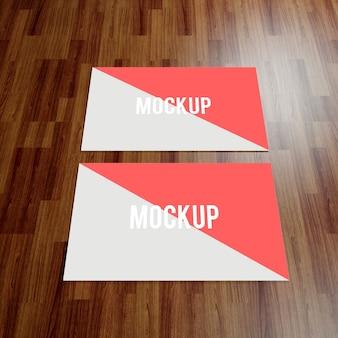 Mock up de tarjeta de negocios sobre suelo de madera