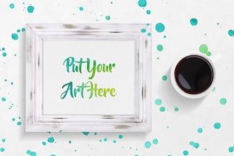 Moldura com pintura e café maquete