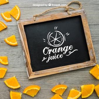 Pedaços de ardósia e laranja