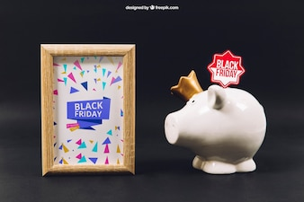 Maquette de vendredi noir avec cadre et tirelire
