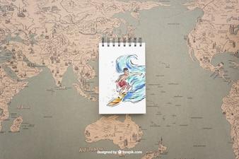 Blocco note sulla mappa del mondo