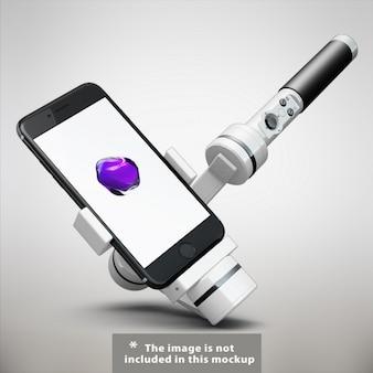 Cellulare con bastone selfie mock up