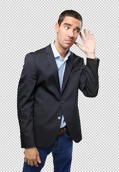 Uomo d'affari preoccupato con sentire il gesto