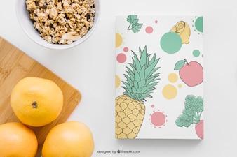 Buchcover Mockup mit Grapefruits