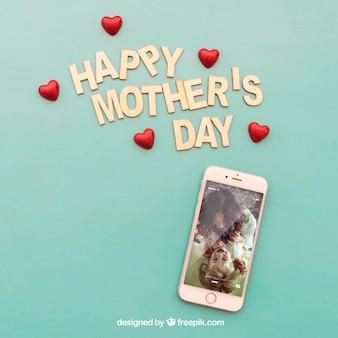 Glückliche Mütter Tag Schriftzug und Smartphone