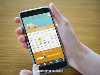 Hand hält Smartphone mit Taxi App