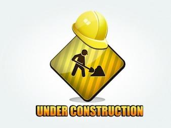 Unter Bau Zeichen mit gelben Helmen auf sie
