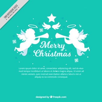 Anges de Noël avec la trompette de fond