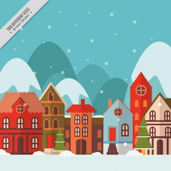 Arrière-plan de belles maisons dans un paysage enneigé en design plat