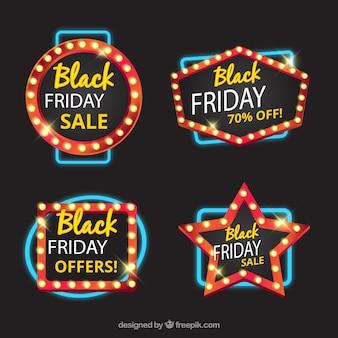 Badges géométriques avec des lumières pour vendredi noir