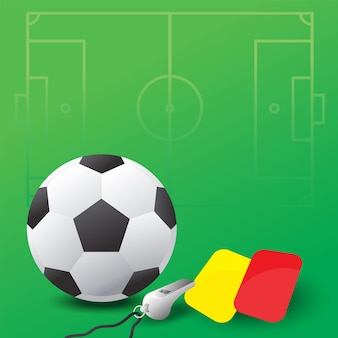 Ballon de soccer, sifflet et cartes rouges et jaunes