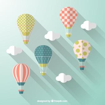 Ballons à air chaud dans le style de design plat