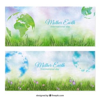 Bannières à l'aquarelle de la pelouse avec le monde