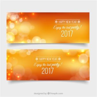 Bannières bokeh nouvelle année d'orange