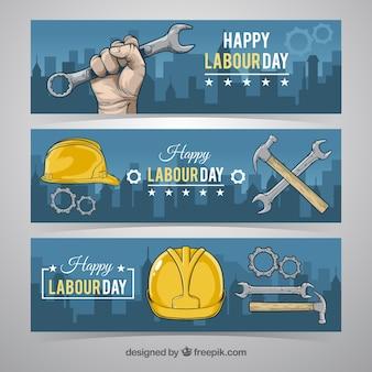 Bannières Casque avec les outils de jour des travailleurs
