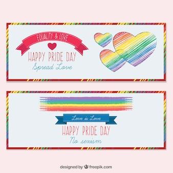 bannières de journée de la fierté peintes à la main coeurs et drapeau