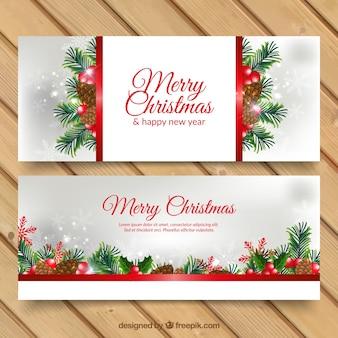 Bannières de Noël avec des pommes de pin et les branches