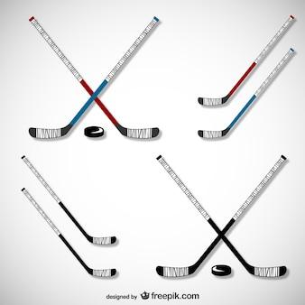 Bâtons de hockey et rondelles fixés