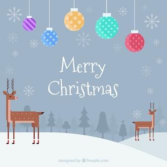 Boules de Noël, cerfs et neige