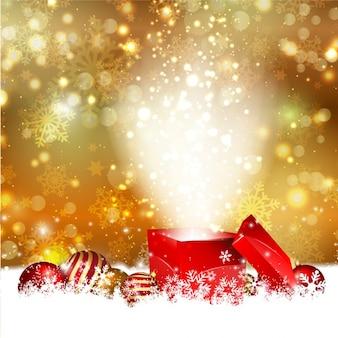 Cadeau ouverte sur un bokeh fond d'or