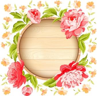 Cadre en bois circulaire avec des fleurs