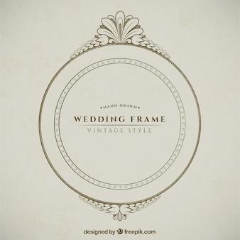 Cadre tiré par la main décorative de mariage ronde