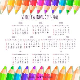 Calendrier scolaire avec des crayons multicolores
