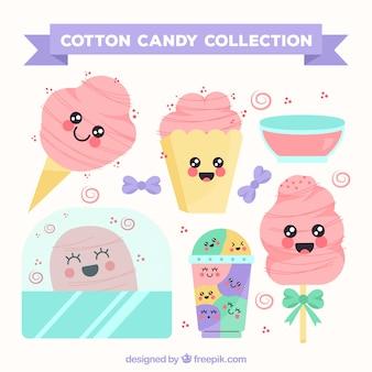 Collection de bonbons en coton avec des visages souriants
