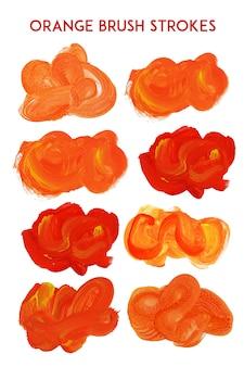 Collection de traits de brosse à l'orange