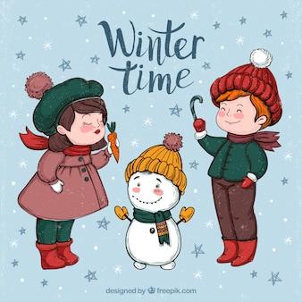 Contexte de beaux enfants avec bonhomme de neige