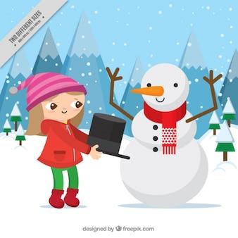 Contexte de la jeune fille de mettre un chapeau sur un bonhomme de neige