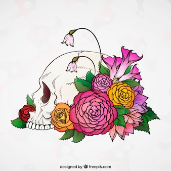 Crâne de fond avec des fleurs colorées dessinés à la main