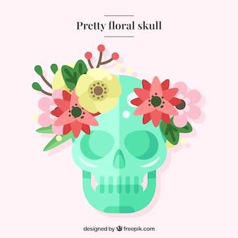 Crâne vert dans la conception plat avec des éléments naturels