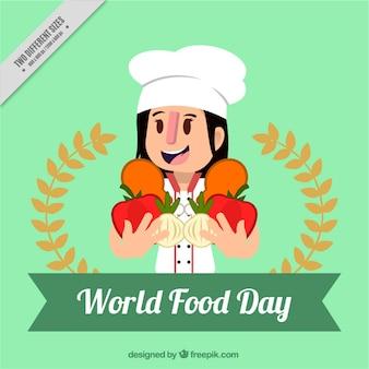 Cuisinier heureux holding légumes