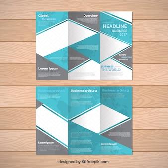 Dépliant d'affaires avec des formes gris et bleu