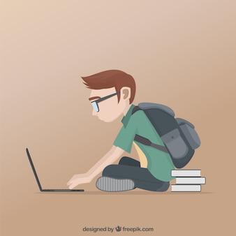 Écolier étudier dans son ordinateur portable