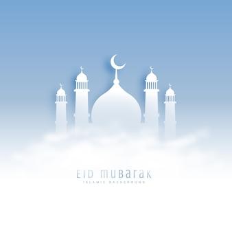 Eid mubarak fond avec mosquée et nuages