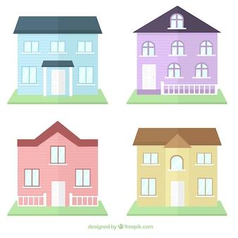 Ensemble de quatre maisons avec des couleurs différentes