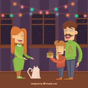 Famille donner des cadeaux de Noël