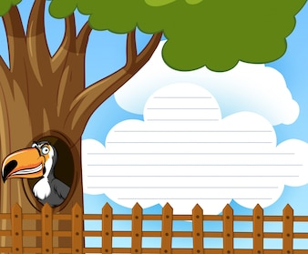 Feuillet avec l'oiseau toucan dans l'arbre